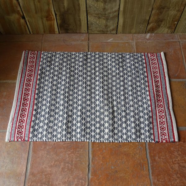 Lavender House Ivory, teal and red pattern rug